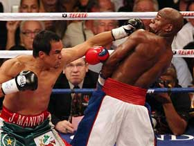 shoulder-roll-defense-mayweather.jpg
